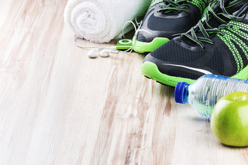 Pair of sport shoes and fitness accessories
