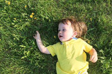 baby lying on grass in summer