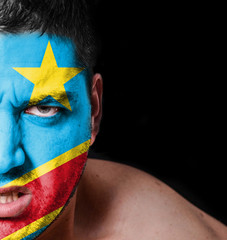 Portrait of angry man with painted flag of Congo Democratic Repu