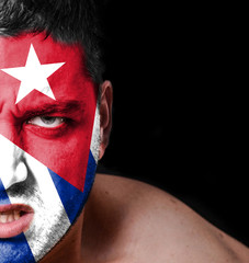 Portrait of angry man with painted flag of Cuba