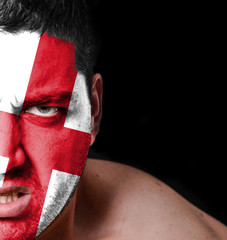Portrait of angry man with painted flag of England