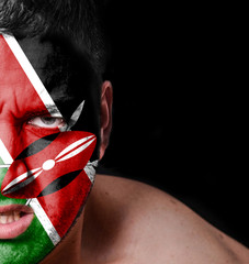 Portrait of angry man with painted flag of Kenya