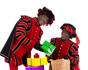 Black Pete  zwarte piet showing gift