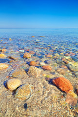 Fresh ocean water with coastal stones. Polish Baltic Sea coast