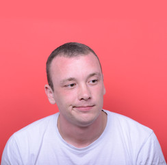 Portrait of desperate man against red background