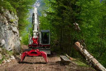 Knuckleboom log loader used for deforestation in clearing