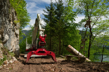 Knuckleboom log loader used for deforestation in clearing