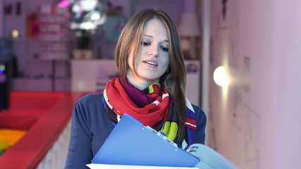 Smiling office worker business woman signs document writes paper