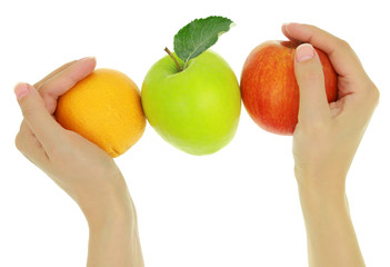 Female hands with a row of fresh colorful fruits
