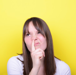 Portrait of girl with finger in her nose