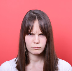 Portrait of girl with serious look against red background