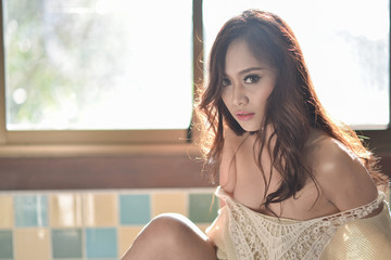 Sexy girl in cream lingerie