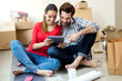 Young couple with digital tablet in their new home