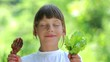 Boy holds a chicken foot and eating salad.