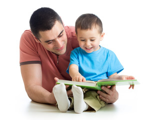 man reading a book to son