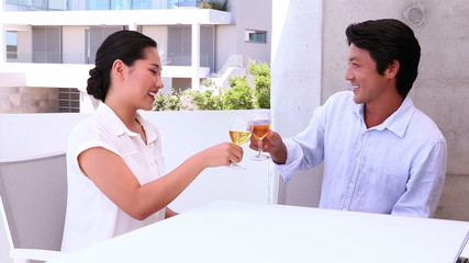Asian couple having white wine together