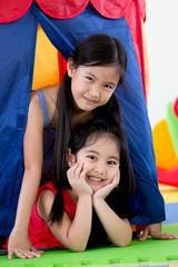 Happy Asian children playing at kindergarten