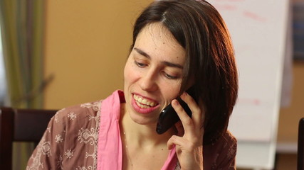 Close-up smiling woman talking over mobile phone, flirt chat