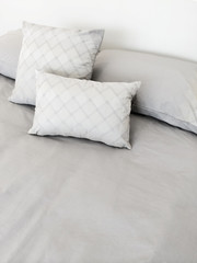 Grey bed linen and pillows