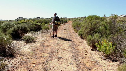 Man hiking through a wild terrain