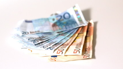 Euro notes falling on white surface