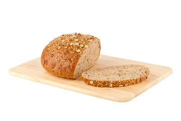 Sliced loaf of homemade bread on a wooden cutting board