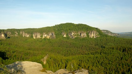 Sunny spring sunrise in a beautiful valley of Saxony Switzerland