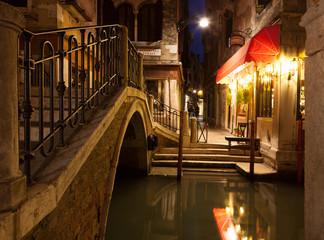 Narrow canal in Venice at night, Italy.  Ponte dei Ferai