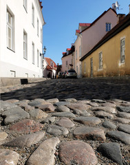 Old town Tallinn street with houses and stone roadway