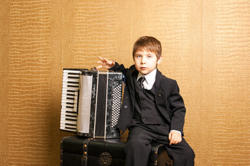 Child plays the accordion