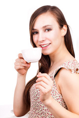 beautiful young woman with cup of hot drink