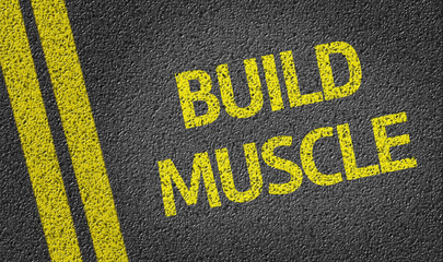 Build Muscle written on the road