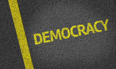 Democracy written on the road