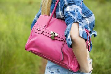 model wearing pink bag