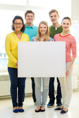 smiling students with white blank board at school