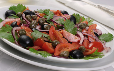 Tomato salad with olives, capers and cilantro