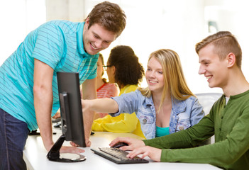 smiling students in computer class at school