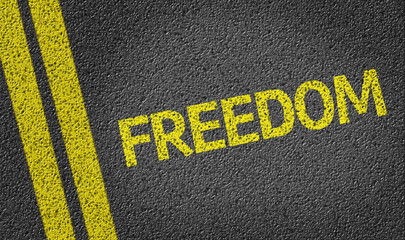 Freedom written on the road