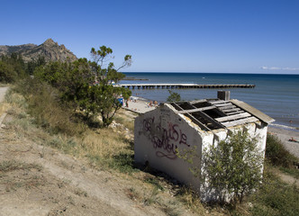 Ruined house on the beach in the Crimea.