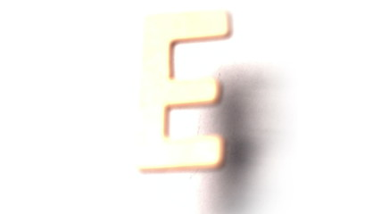 The letter e rising on white background
