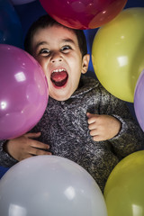 Happiness, boy playing with balloons of many colors