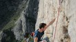 Rock climber struggling with dificult route