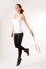 Beautiful girl with a racket in hands