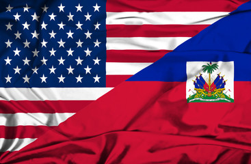 Waving flag of Haiti and USA