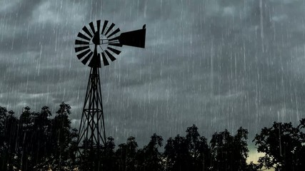 Windmill Silhouette with lightning In Storm Clouds with Rain