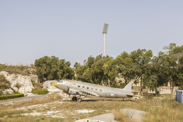 Silver Dakota Douglas DC-3 aircraft with detached wing
