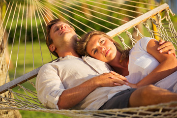 Couple relaxing in tropical hammock