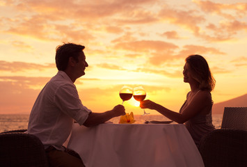 Couple enjoying romantic sunnset dinner