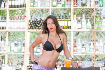 Woman in bikini at the summer beach bar