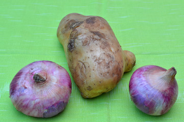 potato and onions on cotton cloth